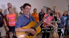 "Harperman, a Protest Song | Published on Jun 22, 2015 | https://youtu.be/Ei50lM6ab1c | ""Harperman is a protest song against the Conservative govt of Canadian PM Stephen Harper. We are organizing a cross-Canada singalong of Harperman on 9/17, just a month before the expected date of the Canadian fed election. Please contribute, if you can, to helping organize the singalong. A new campaign has been launched at https://www.indiegogo.com/projects/cross-canada-harperman-sing-along#/story"
