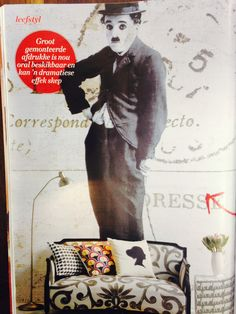 Mitat's Charlie Chaplin wallpaper featured in Idea's Magazine looks incredible behind this couch.