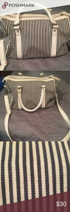 Striped weekender bag This canvas weekender bag is perfect for the grab and go weekend! It's on the small side so it's perfect for a quick getaway. Some normal wear and tear as well as a couple of discolorations are shown in pictures. Francesca's Collections Bags Travel Bags
