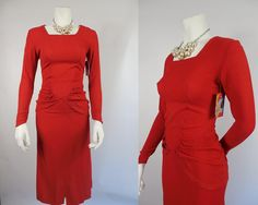 This gorgeous tomato red crepe rayon dress hugs every curve! It has long sleeves that come to a point at the wrist and a square neckline. the