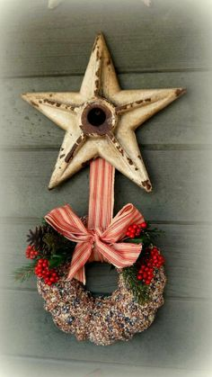 Perfect combo...old iron star and bundt pan birdseed wreath