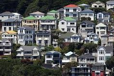 Photo about Frontal view of the iconic Oriental Bay villas within dense green bush and trees, in Wellington, capital city of New Zealand. Image of colored, view, city - 82844838 Wellington City, Wellington New Zealand, Selling Real Estate, Real Estate Companies, Property Prices, House Prices, Face Home, New Zealand Houses, Home Fix