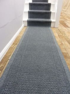 Grey carpet on white stairs