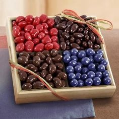 Chocolate Covered Bliss Fruit and Nuts Tray #easter #chocolate Everything is better coated with chocolate! This decadent collection of chocolate covered dried blueberries, cherries, almonds and cashews in a carved wooden tray makes a sweet gift for any occasion.   Everything is chocolate covered on this sweet gift tray. Chocolate covered nuts: amonds and cashews. Chocolate covered fruit: dried blueberries and dried cherries. Presented in a wooden tray with carved handles and tied with a…