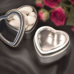 Heart Shaped Mint Tins - Freshen up your special occasion with these Heart Shaped Mint Tins! These heart shaped matte silver mint tins make refreshing party favors all your guests will enjoy.  http://www.favorfavor.com/page/FF/PROD/4680