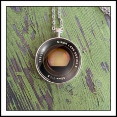 A personal favorite from my Etsy shop https://www.etsy.com/listing/499368928/nikon-camera-lens-photo-necklace
