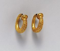 Etruscan gold trumpet-shaped earrings with relief decoration C.500BC The MET