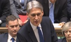 Philip Hammond has admitted that the Brexit votes blow to the economy would force the government to borrow 122bn more than hoped.