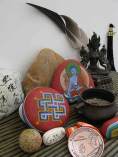 Home altar with painted stones - paying homage to various religions and beliefs by placing diverse objects together