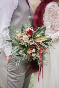 Beautiful Christmas wedding bouquet with magnolia leaves and fern