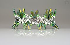 »Dragonfly Wings I.« bracelet with Potomac Bead Company beads like AVA beads, RounDuo and PC Rondelles; together with 2-hole daggers, 2-hole bars, Miyuki seed beads and stainless steel findings.