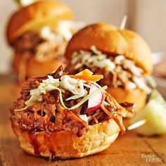 Balsamic Honey Pulled Pork Sliders Serve up a tray of saucy pulled pork sliders from the slow cooker at your fall potluck. The 320-calorie sandwiches feature a homemade honey barbecue sauce with a fresh hint of rosemary and thyme.