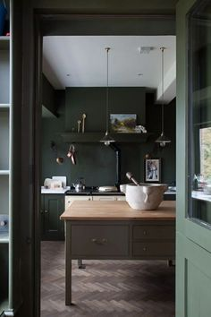 Like this cabinet color esp how it looks in back under white counter top