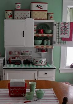 Kitschy Kitchen  Not sure why, but I am drawn to this type of kitchen. Maybe because it reminds me of my Granny Lowe.