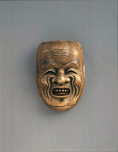 The Nobori-hige mask is characterized by his long beard and also long  bristling-up sideburns (though they are missing now). The smiling face with  deep wrin...