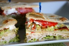 Most of a classic club sandwich ingredients are here; bacon, turkey or chicken, cheese, lettuce and tomatoes. Instead of three layers of t...
