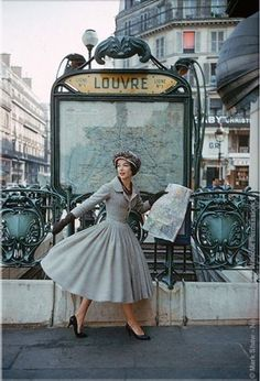 Christian Dior - 1957 - Paris Louvre Metro Station - Photo by Mark Shaw - A Bright Young Look in Paris - LIFE magazine - (Métro Louvre Rivoli in Paris, Built: 1900, Architect: Hector Guimard, Art Nouveau) - https://www.1stdibs.com/art/photography/color-photography/mark-shaw-grey-dior-outside-paris-louvre-metro/id-a_84572/