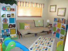 Colorful Playroom with lots of Storage, Small playroom with a ton of storage and very colorful and bright, As you walk into the playroom. The futon in the room is mostly used as a couch, but is also used as a bed for guests. Underneath the futon are two dresser drawers that hold dress up clothes and jewelry for my daughter.  , Other Spaces Design