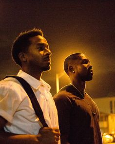 "Andre Holland, left, and Trevante Rhodes in ""Moonlight."" Directed by Barry Jenkins  (David Bornfriend/A24 via AP)"
