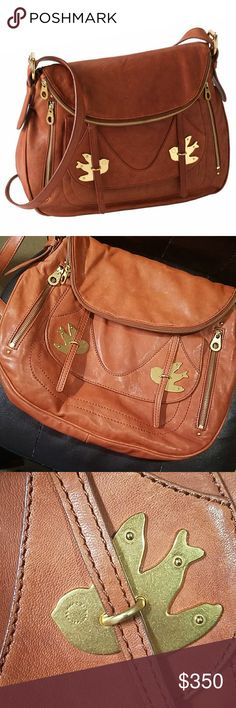 RARE Marc by Marc Jacobs Petal to the Metal Sasha 🌟MAKE AN OFFER🌟 100% Authentic!  I'm also selling my black MBMJ PTTM so please check that out too! This is a great roomy bag but it's too large for my taste. It has a stain on the back from rubbing against jeans but it's not noticeable when carried. Other than that it's in great condition! The leather is so buttery soft and I don't see that in newer MBMJ bags. Marc By Marc Jacobs Bags