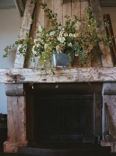 Rustic green floral arrangement over a wooden fireplace (Photo by Little White Dress) Wooden Fireplace, Rustic Fireplaces, Country Fireplace, Wood Mantle, Fireplace Mantles, Fireplace Decorations, Fireplace Ideas, Rustic Mantel, Rustic Decor