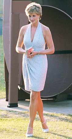 1995 | She showed off her toned shoulders in a plunging beaded cocktail dress by Catherine Walker. | InStyle 19