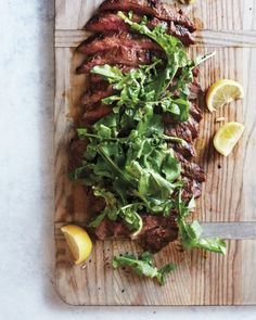 """Soy-Lemon Flank Steak with Arugula - It's easy to make and uses an inexpensive cut of steak, plus """"the meat is marinated, which gives it a really great flavor,"""" says recipe tester Laura Rege about her new favorite meaty main. """"Slice it and garnish with the arugula when you get to the potluck."""""""