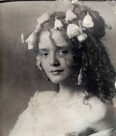 Flowers in her hair, who is she? When?