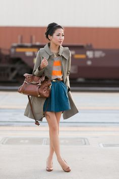 Trench Coat, nude & orange striped shirt, teal leather skater skirt, brown skinny waist belt, statement necklace