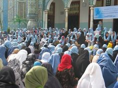 Women in Mazar, Afghanistan praying for peace (2008) in their blue scarves.