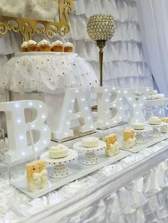 White and gold heaven themed baby shower party! See more party planning ideas at http://CatchMyParty.com!