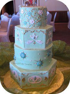 Elegant Seam Foam Green, Gold and Ivory Wedding Cake