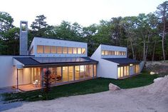 Project Greenhouse, which we covered at Sundance a few month ago, has opened up shop in the Hamptons, New York's home for vacation homes. Designed by architect Edvin Karl Stromsten to accent a secluded stretch of forest he already owned, the house was