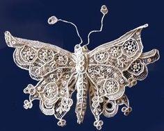 Butterfly work in Point de Gaze lace.