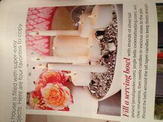Beautiful candles and jingle bells centerpiece - via HGTV magazine