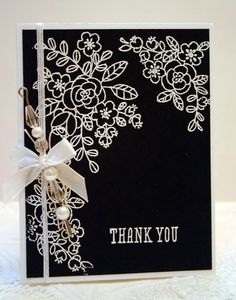 So Very Grateful stamp set used with white embossing ink on tuxedo black paper creates a stunning and elegant handmade thank you card.