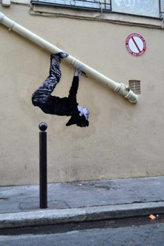 The talented artist decorates his city with imaginative wheat-paste images that seem to come alive. He often displays the paste-up characters interacting with 3d materials, like windowsills, electrical cords, and support beams that are already there, as well as throwing his own props into the mix.