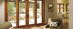 Replace the 1970's 8ft sliding door with sliding french doors to open into solarium.