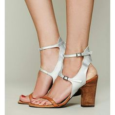 NWB Free People Corsica Heels Brand new silver and tan leather strappy heeled sandal with adjustable buckle strap around the ankle and across the front of the foot. Rubber sole. Chunky brown 4 inch heel. Free People Shoes Sandals