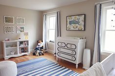Amazing blue boy's nursery features a white and navy changing table dresser, Annette Tatum Beverly White with Navy Trim Dresser, situated below bunny art flanked by windows dressed in white and navy ribbon trim curtains. Baby Boys, Preppy Baby Boy, Baby Boy Rooms, Baby Boy Nurseries, Trendy Baby, Preppy Bedroom, Tan Bedroom, Navy Blue Nursery, Changing Table Dresser
