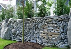 Gorgeous Stone Wall Mosaics Flow in Beautiful Spirals and Waves - My Modern Met