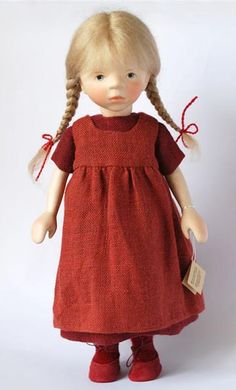 """*GIRL IN RED JUMPER ~ 2011, 14"""", wooden doll features Elisabeth's signature hand carved, poseable body. She has delicate hand-painted features and a blond mohair wig."""