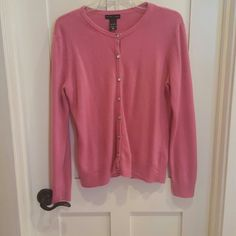 Sweater Cardigan Beautiful pink sweater. Buttons look like diamonds. Great for work or play. A must have in your closet. Worn a few times. In excellent condition. No tears or stains. New York & Company Sweaters Cardigans