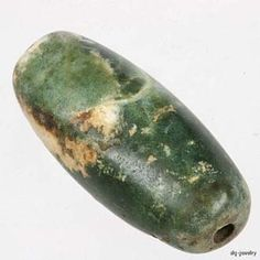 Ancient Green Stone Bead - Afghanistan. Beautiful green stone bead with a nephrite jade - like appearance. Probably serpentine or green jasper.