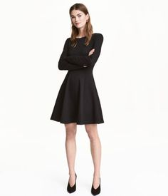 Black. Short dress in thick, textured jersey with a wider neckline. Long sleeves, a seam at waist, and a flared skirt. Unlined.