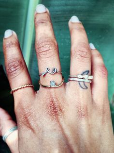 Mouré LA LA Ring, 14k grey diamond Curve ring, 14k Twisted Fate ring and custom 3 diamond ring.