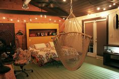 I originally wanted a hammock AS my bed but I figured that might be awkward if I have any adult sleepovers.  Maybe just one in my room will suffice.  Also, this is a great color scheme.