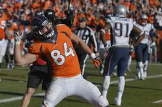 Denver Broncos tight end Jacob Tamme (84) celebrates his touchdown during the first half of the AFC Championship NFL playoff football game against the New England Patriots in Denver, Sunday, Jan. 19, 2014. (AP Photo/Jack Dempsey)