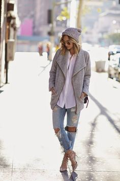Perfect. Ripped jeans, a white blouse, grey knit and a oversized jacket.