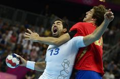 TOPSHOTS  France's centreback Nikola Karabatic (L) vies with Spain's leftback Viran Morros de Argila during the men's quarter-final handball match Spain vs France for the London 2012 Olympics Games on August 8, 2012 at the Basketball Arena in London.   AFP PHOTO / JAVIER SORIANOJAVIER SORIANO/AFP/GettyImages Photo: Javier Soriano, AFP/Getty Images / SF